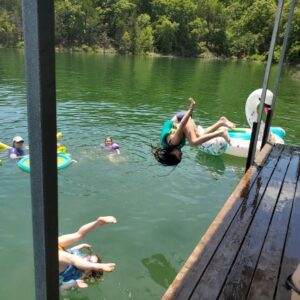 Family swimming a dock